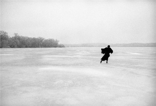 Joni Mitchell skating away on a river. Photo by Joel Bernstein.