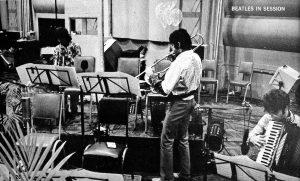 John on accordion, Paul on trombone, George on trumpet