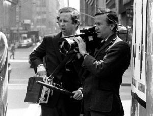 "FILE - In this July 1969 file photo, documentary filmmakers David, left, and Albert Maysles work on the streets of New York for ""Salesman."" Albert Maysles, who along with his brother David made works of ""cinema verite"" in the 1960s and '70s, including the Rolling Stones documentary ""Gimme Shelter,"" died Thursday, March 5, 2015 in New York. He was 88. His brother David Maysles died in 1987. (AP Photo, File)"